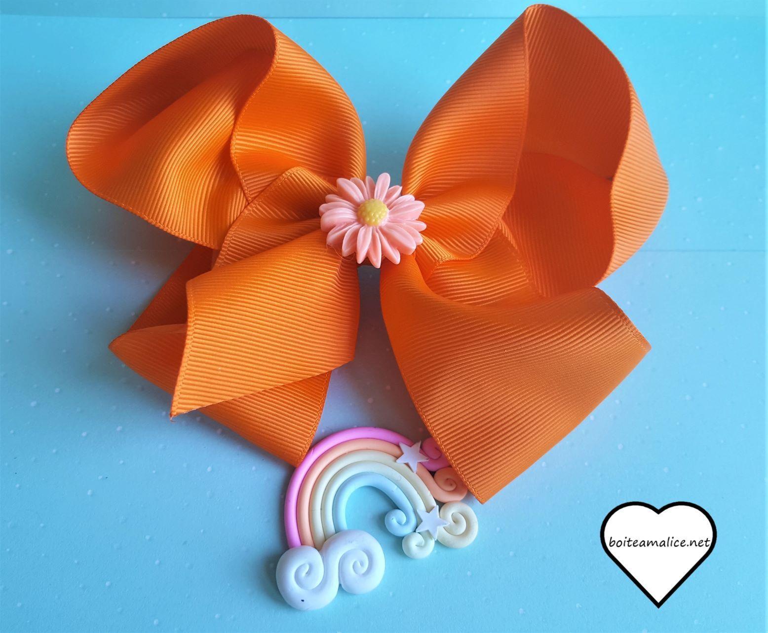 Barrette noeud orange fleur